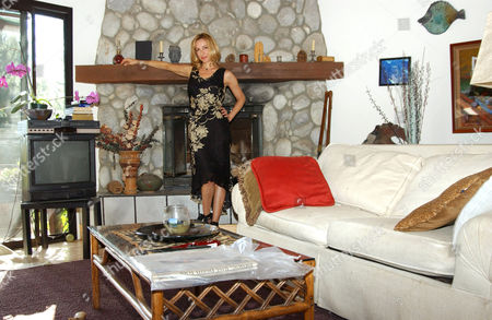 Stock Photo of Judi Beecher, the American actress who is a sexy and magical blend of strength and vulnerability with a splash of quirkiness. Judi will be appearing in the new movie 'Danny Love's Angie', that she shot in Dover, New Hampshire. She has just returned from four months in France where she produced, directed and starred in the documentary feature 'Finding Isabelle: A Search For Life After Death', which she is hoping to present at the forthcoming Venice Film Festival, and defiantly at the American Film Festival in Deauville, France. In 2006 we have seen Judi starring in the independent feature, 'Four Weeks, Four Hours'. Judi began her career at the age of three. She produced, directed and starred in basement productions with a cast of cousins and an audience of relatives. At 10 she formed the Beecher Sisters, a singing group with her sister Andrea. They performed at birthday parties in her home town of Great Neck, Long Island. She's modeled in France, Italy and New York. She sang in the south of France next to the Gypsy Kings, and appeared in Cologne and Barcelona as a chanteuse. She's lived around the world and speaks French and Italian fluently and Spanish conversationally. Her first professional acting job in America was with Woody Allen in 'Coop Italia', a string of TV commercials for the Italian market.