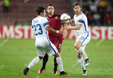 Sparta's Daniel Holzer, center, tries to dribbles past Inter Milan's Citadin Martins Eder, left, and Inter Milan's Cristian Ansaldi during the Europa League group K soccer match between Sparta Praha and Inter Milan in Prague, Czech Republic