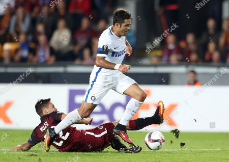 Inter Milan's Citadin Martins Eder, top, is tackled by Sparta's Daniel Holzer during the Europa League group K soccer match between Sparta Praha and Inter Milan in Prague, Czech Republic