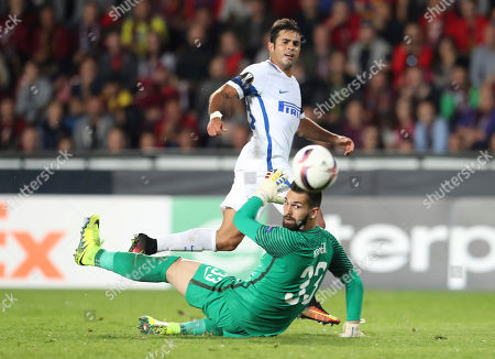 Inter Milan's Citadin Martins Eder, top, kicks the ball to past Sparta goalkeeper Tomas Koubek during the Europa League group K soccer match between Sparta Praha and Inter Milan in Prague, Czech Republic