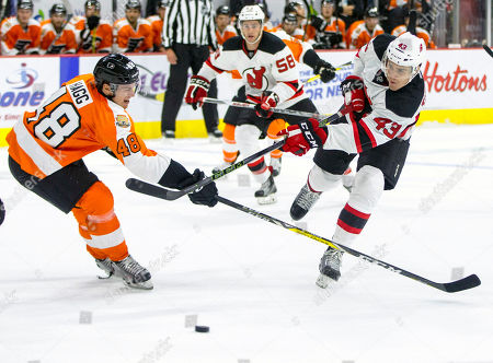 Robert Hagg, Ben Thomson New Jersey Devils' Ben Thomson, right, shoots the puck with Philadelphia Flyers' Robert Hagg, left, defending during the first period of a preseason NHL hockey game, in Allentown, Pa