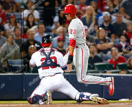 Anthony Recker, Aaron Altherr Atlanta Braves catcher Anthony Recker (20) tags out Philadelphia Phillies' Aaron Altherr (23) at home plate during the fifth inning of a baseball game, in Atlanta