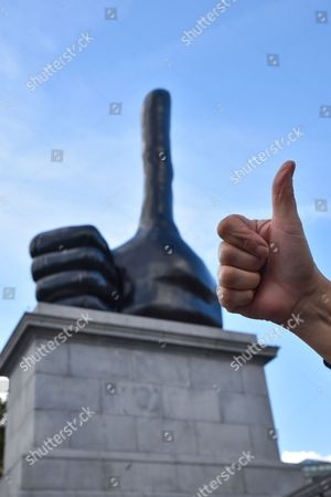 "Thumbs Up ""Really Good"" by David  Shrigley on the Fourth Plinth in Trafalgar Square."