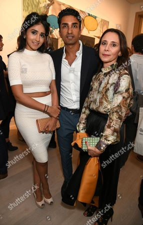 Stock Picture of Esha Arora, Robin Arora and Emily Tsingou
