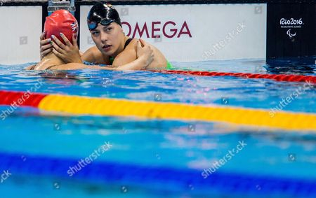 Stock Image of Hannah Russell of Great Britain Naomi and Maike Schnittger of Germany celebrate after the Swimming Women's 50m Freestyle - S12 Final
