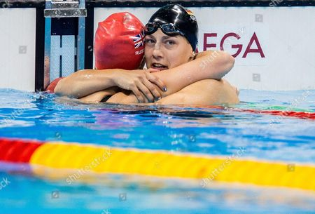 Hannah Russell of Great Britain Naomi and Maike Schnittger of Germany celebrate after the Swimming Women's 50m Freestyle