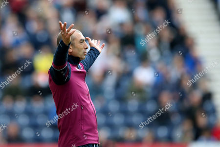 Aston Villa manager Roberto Di Matteo gestures with both arms out wide during the SKY BET Championship match between Preston North End and Aston Villa played at Deepdale, Preston on 1st October 2016