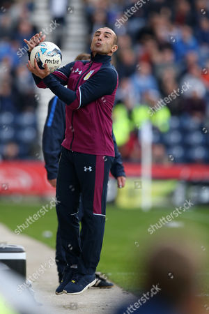 Aston Villa manager Roberto Di Matteo jumps to catch the match ball during the SKY BET Championship match between Preston North End and Aston Villa played at Deepdale, Preston on 1st October 2016