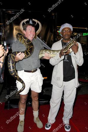 Snake handler Jules Sylvester holding a snake with Samuel L Jackson