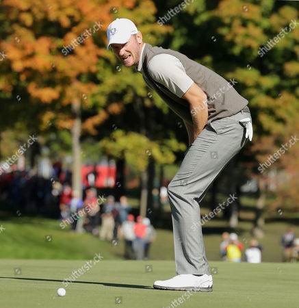 Europe's Chris Woods reacts to a missed putt on the 13th hole during a foresomes match at the Ryder Cup golf tournament, at Hazeltine National Golf Club in Chaska, Minn