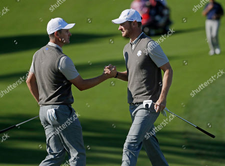 Europe's Justin Rose congratulates Europe's Chris Woods on his putt on the 10th hole during a foresomes match at the Ryder Cup golf tournament, at Hazeltine National Golf Club in Chaska, Minn