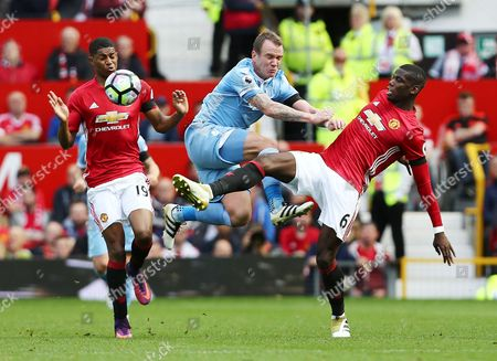 Paul Pogba of Manchester United and Glenn Whelan of Stoke City during the Premier League match between Manchester United and Stoke City played at Old Trafford, Manchester on 2nd October 2016