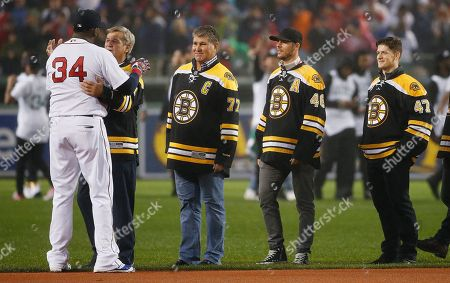 David Ortiz, Bobby Orr, Ray Bourque Boston Red Sox's David Ortiz (34) greets former Boston Bruins Bobby Orr, center, as former Bruins' Ray Bourque, right, and current Bruins players look on during ceremonies honoring Ortiz before a baseball game against the Toronto Blue Jays in Boston