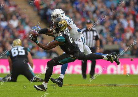 Allen Robinson (15) of the Jacksonville Jaguars catches the ball ahead of Antonio Cromartie of the Indianapolis Colts during the NFL International Series Football match between Indianapolis Colts and Jacksonville Jaguars played at Wembley Stadium, London on 2nd October 2016