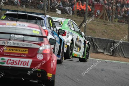 Rob Austin (Toyota) leads Jason Plato (Subaru) and Josh Cook (MG)during first race of  the final round of the Dunlop MSA British Touring Car Championship (BTCC) at Brands Hatch's Grand Prix circuit.