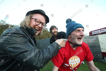 Stock Image of Little Mammoths - Matt Owens and Jimmy Besley sign Inverness festival-goer David Livingstone's t-shirt