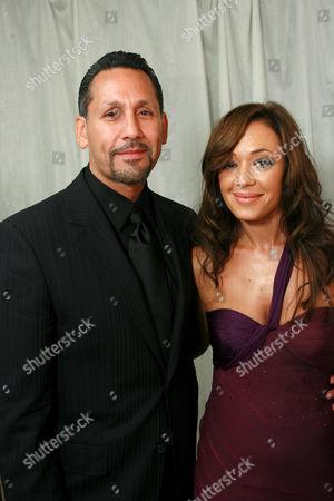 Angelo Pagan and Leah Remini.