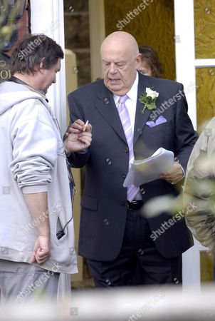 John Savident begs a cigarette between takes. Unlucky in love Fred Elliott, played by John Savident, stops off at Audrey's house before his wedding to Bev Unwin only to end up being bought out face covered on a stretcher. He left the church to try and pursuade Audrey, played by Sue Nicholls, to attend, when she agrees he drops dead infront of her.