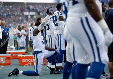 Indianapolis Colts cornerback Antonio Cromartie (31) kneels down during the national anthem before an NFL football game between the Indianapolis Colts and the Jacksonville Jaguars at Wembley stadium in London