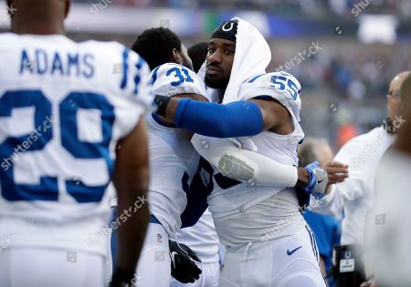 Indianapolis Colts cornerback Antonio Cromartie (31) is embraced by Indianapolis Colts inside linebacker Sio Moore (55) after kneeling during the national anthem before an NFL football game between the Indianapolis Colts and the Jacksonville Jaguars at Wembley stadium in London