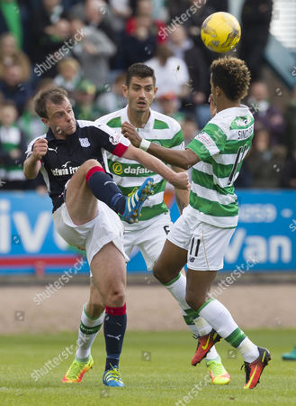 L to R: Paul McGowan of Dundee, Nir Bitton & Scott Sinclair of Celtic during the SPFL Ladbrokes Premiership match between Dundee & Celtic at Dens Park, Dundee on 1st October