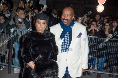 Paris Fashion Givenchy arrivals US comedian and talk show host Steve Harvey, right, and his wife Marjorie Harvey pose for photographers on arrival for Givenchy's Spring-Summer 2017 ready-to-wear fashion collection presented in Paris
