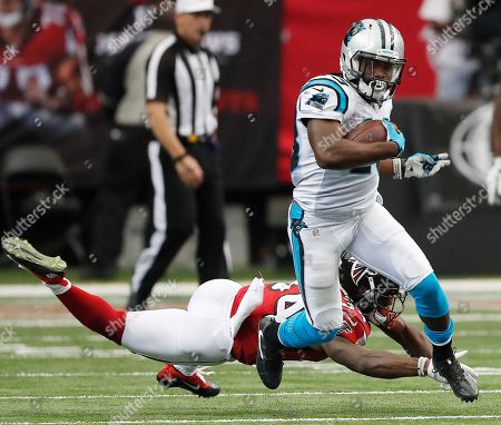Carolina Panthers running back Fozzy Whittaker (43) runs by Atlanta Falcons defensive back Brian Poole (34) during the first half of an NFL football game, in Atlanta