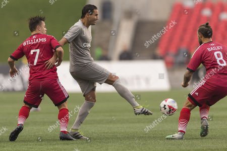 Puerto Rico FC Paulo Ferreira Mendes (11) kicks the ball while Ottawa Fury FC Ryan Williams (7) and James Bailey (8) defend on the play during the match between Puerto Rico FC and Ottawa Fury FC at TD Place in Ottawa, ON, Canada. Puerto Rico FC won the match by a score of 2-1