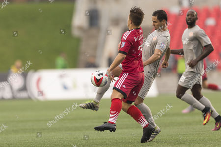 Puerto Rico FC Paulo Ferreira Mendes (11) and Ottawa Fury FC Ryan Williams (7) battle for the ball during the match between Puerto Rico FC and Ottawa Fury FC at TD Place in Ottawa, ON, Canada. Puerto Rico FC won the match by a score of 2-1