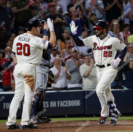 Nick Markakis, Anthony Recker Atlanta Braves' Nick Markakis, right, high-fives teammate Anthony Recker after hitting a home run in the sixth inning of a baseball game against the Detroit Tigers in Atlanta
