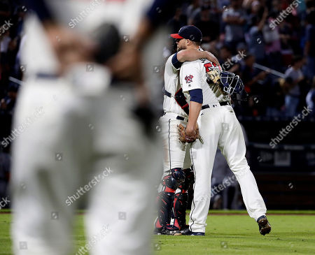 Jim Johnson, Anthony Recker Atlanta Braves relief pitcher Jim Johnson, right, hugs catcher Anthony Recker after the Braves beat the Detroit Tigers 5-3 in a baseball game in Atlanta