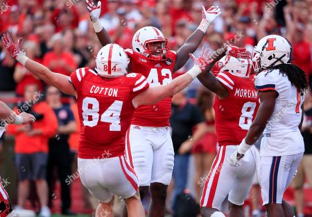 Trey Foster, Sam Cotton, Stanley Morgan Jr., Jaylen Dunlap Illinois defensive back Jaylen Dunlap, right, watches as Nebraska tight end Trey Foster (42) celebrates with teammates tight end Sam Cotton (84) and wide receiver Stanley Morgan Jr. (8) after he scored a touchdown against Illinois during the second half of an NCAA college football game in Lincoln, Neb., . Nebraska won 31-16
