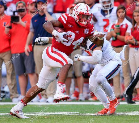 Terrell Newby, Taylor Barton Nebraska running back Terrell Newby (34) runs past Illinois defensive back Taylor Barton (3) during the second half of an NCAA college football game against Illinois in Lincoln, Neb., . Nebraska won 31-16