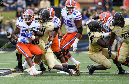 Charles Wright #11 tackles running back Lamical Perine #22 during the NCAA Football game between the Florida Gators and the Vanderbilt Commodores at Vanderbilt Stadium in Nashville, TN Photo by Thomas McEwen/Cal Sport Media