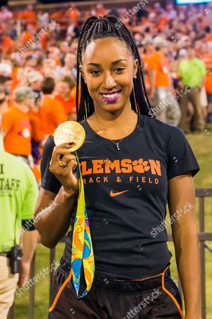Olympic gold medalist Brianna Rollins runs down the hill during the NCAA football game between the Louisville and Clemson on at Death Valley, Clemson, SC