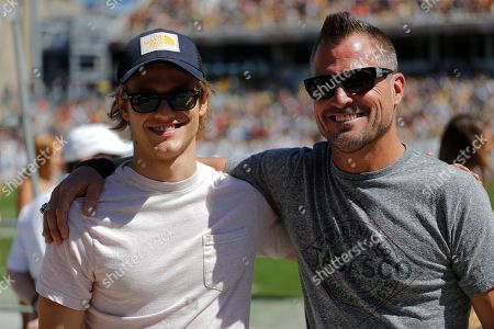 Stock Picture of Actor Lucas Till who is seen on MacGyver TV Show, left, and actor George Eads pose for a photo during the first half of an NCAA college football game between Georgia Tech and Miami, in Atlanta