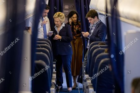Hillary Clinton, Brian Fallon, Nick Merrill, Huma Abedin Democratic presidential candidate Hillary Clinton, second from left, accompanied by senior aid Huma Abedin, second from right, and Traveling Press Secretary Nick Merrill, right, speaks with National Press Secretary Brian Fallon, left, aboard her campaign plane in White Plains, N.Y., before traveling to Toledo, Ohio