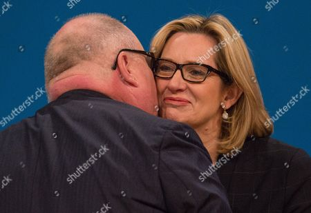 Eric Pickles kissing Amber Rudd