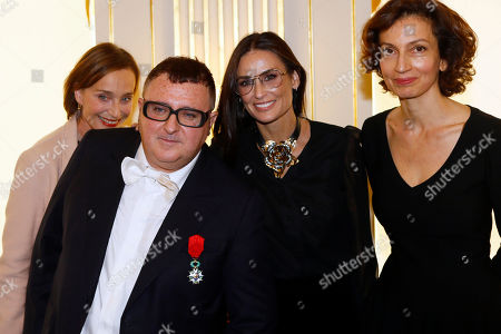 Israeli American fashion designer Alber Elbaz, second left, poses with, from left, actress Kristin Scott Thomas, actress Demi Moore, and French Culture Minister Audrey Azoulay after being awarded with the Officier de la Legion d'Honneur (Officer of the Legion of Honor) medal during a ceremony at the Culture Ministry in Paris
