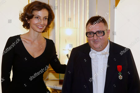 French Culture Minister Audrey Azoulay, left, poses after awarding Israeli American fashion designer Alber Elbaz with the Officier de la Legion d'Honneur (Officer of the Legion of Honor) medal during a ceremony at the Culture Ministry in Paris