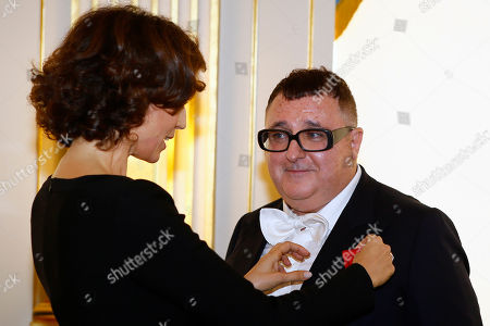 French Culture Minister Audrey Azoulay, left, awards Israeli American fashion designer Alber Elbaz with the Officier de la Legion d'Honneur (Officer of the Legion of Honor) medal during a ceremony at the Culture Ministry in Paris