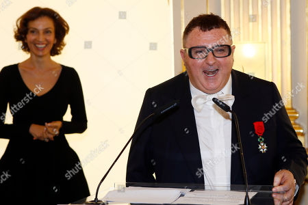 Israeli American fashion designer Alber Elbaz delivers his speech after French Culture Minister Audrey Azoulay, left, awarded him with the Officier de la Legion d'Honneur (Officer of the Legion of Honor) medal during a ceremony at the Culture Ministry in Paris