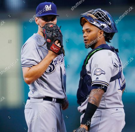 Martin Maldonado, Brent Suter Milwaukee Brewers pitcher Brent Suter, left, confers with catcher Martin Maldonado after Suter gave up an infield single to Colorado Rockies' David Dahl during the first inning of a baseball game, in Denver