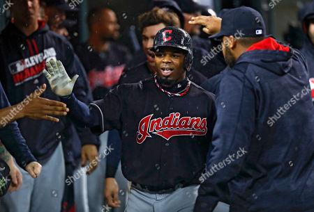 Rajai Davis Cleveland Indians' Rajai Davis is congratulated after scoring on a Carlos Santana single against the Detroit Tigers in the fourth inning of a baseball game in Detroit