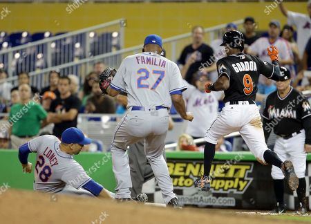James Loney, Dee Gordon, Jeurys Familia New York Mets first baseman James Loney (28) tags first base as Miami Marlins' Dee Gordon (9) is out for the last out in the ninth inning during a baseball game, in Miami. The Mets defeated the Marlins 5-2. At center is New York Mets relief pitcher Jeurys Familia (27