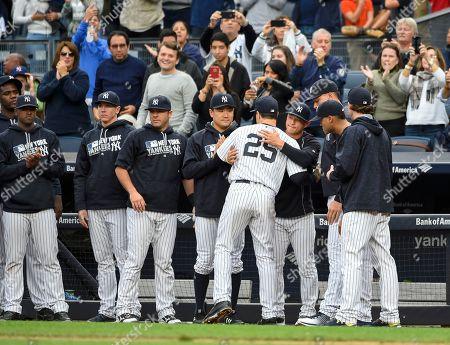Mark Teixeira New York Yankees Mark Teixeira hugs teammates as he leaves the baseball game, in New York. Teixeira is retiring after the game