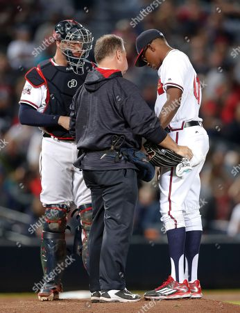 Tyrell Jenkins, Jim LOvell, Tyler Flowers Atlanta Braves trainer Jim Lovell, center, tends to relief pitcher Tyrell Jenkins (61) who was injured in the eighth inning of a baseball game against the Detroit Tigers, in Atlanta. Braves catcher Tyler Flowers, left, looks on