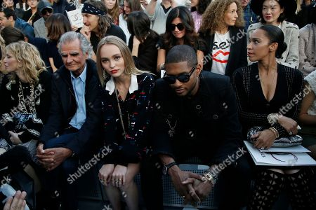 From left, Patrick Demarchelier, Lily Rose Depp, Usher and an unidentified person wait prior Chanel's Spring-Summer 2017 ready-to-wear fashion collection presented Tuesday, Oct.4, 2016 in Paris