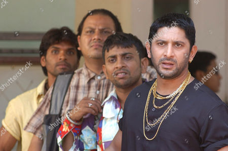 Indian film star Arshad Warsi who plays Circuit with some of his co stars in a scene from the film comedy 'Lage Raho Munna Bhai'