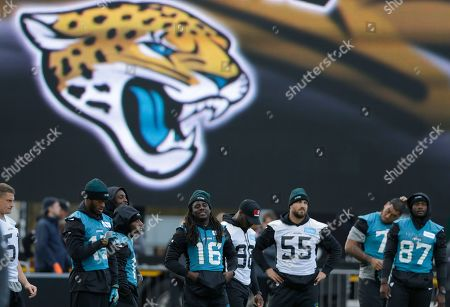Jacksonville Jaguars running back Denard Robinson, (16), with teammates linebacker Dan Skuta (55) and wide receiver Allen Robinson(15), second left, take part in an NFL practice session at the Allianz Park rugby stadium in London, . The Jacksonville Jaguars are due to play the Indianapolis Colts at Wembley stadium in London on Sunday in a regular season NFL game